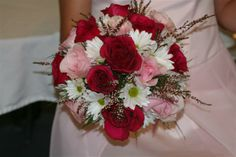 I want to carry red roses and daisies if I ever get married. They represent both true and innocent love.