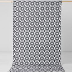 Spira Juline Black Swedish Fabric from Hus & Hem.  It's easy to breathe new life into your home, just add Spira's striking Juline fabric to your room for an instant pop of print.  The pretty tile pattern features a monochrome palette with a hint of grey.  Mix Juline with Spira's many designs to create a home that is full of Nordic colour and joy.  Ideal for curtains, blinds and soft furnishing projects.