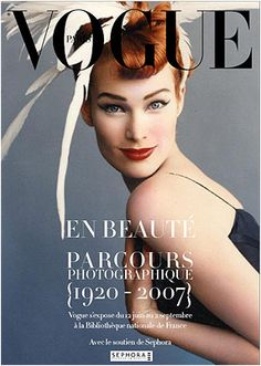 Paris Vogue. Nice pose. Notice how the grey background matches the iris colour.