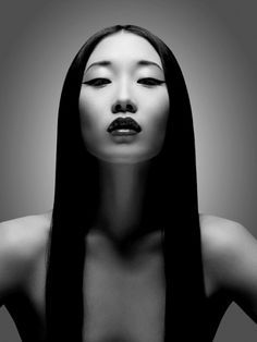 The models middle parting creates a line of symmetry, which creates a balance in the photo. The light behind her makes the model stand out and pushes your focus right to her face