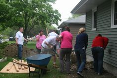 Volunteers working together to remove stones from a property  #aurora #oswego http://www.foxvalleyhabitat.org  Help Others and Volunteer Today!