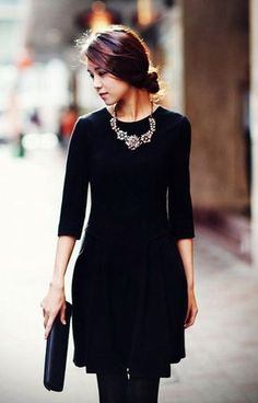 Perfect hair, perfect little black dress, love the statement necklace but maybe I would add a bit of color having a different clutch