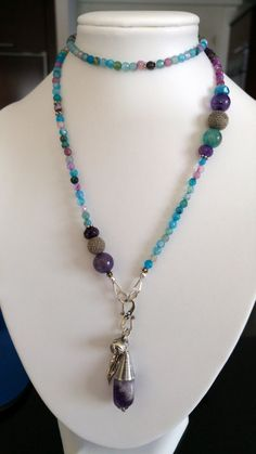 A playful dragons vein agate necklace at the moment in two color variation...others to come.  blue-purple variation: necklace made of blue and purple