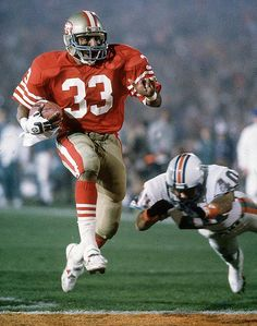 Roger Craig of the San Francisco crosses the goal line for one of his three  touchdowns against the Miami Dolphins in Super Bowl XIX 14304f950