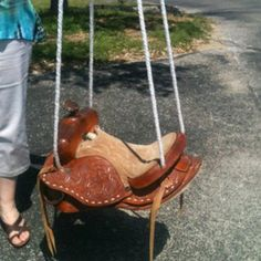 Saddle swing! To replace the old tire in the back yard- Chris would be all sorts of on board with this.