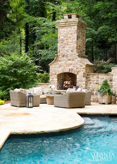 Outdoor fireplace placed on pool patio. Enchanting outdoor area with pool, patio and outdoor fireplace. Outdoor Fireplace Designs, Backyard Fireplace, Backyard Patio, Backyard Landscaping, Fireplace Outdoor, Fall Fireplace, Backyard Seating, Landscaping Design, Outdoor Seating