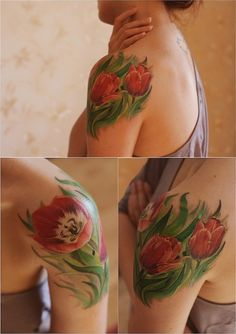 Realistic Tulips tattoo......super rare to see tulips tattooed in this style. LOVE.