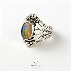 Ethiopian Opal Ring A flat faceted ethiopian opal in sterling silver. Opal Rings, Gemstone Rings, Lotus Ring, Ethiopian Opal Ring, Gemstones, Sterling Silver, Jewelry, Jewlery, Bijoux