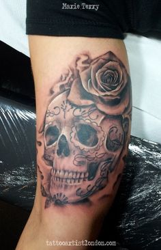 ... realistic tattoo of a sugar skull with rose. Tattooed in black and