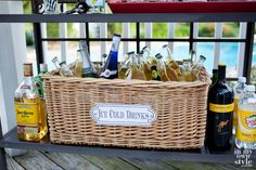 "Throw an outdoor party in style by making this simple party cooler using a basket. Plus ""Ice Cold Drinks"" free printable label to download and use 