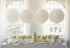 To glam up the feel of the white party, try to make everything white and let the natural setting be the only color. This also makes your decorating job much easier! White table cloths and a white tent and you're practically done. If you want to add some extra decorations, stick with something simple. I love the look of these giant white balloons! Sleek and modern!