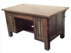 Circa 1910 Craftsman Desk - $850  This heirloom bears hallmarks of the Craftsman (also called Mission) aesthetic, a style of furniture and architecture inspired by the English Arts and Crafts movement, itself developed in the late 1800s
