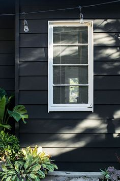 Benjamin Moore Paint: Siding: Aura exterior in flat Onyx Black 2133-10. Trim: Aura exterior Grand Entrance in satin Oxford White 869
