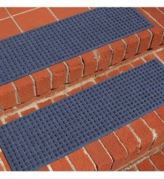 The Square Carpet Stair Treads give you a simple way to accent your indoor or outdoor stairs. The strong polypropylene fibers are designed to trap loose dirt and absorb excess moisture from your shoes, ensuring your shoes are clean by the time you reach the top of the stairwell. The rugs stay in place on each step thanks to the non-slip rubber backing. The top of the stair tread rugs feature striking square designs and come in several different colors to blend seamlessly into most any decor.