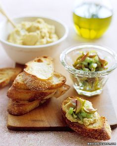 In this recipe, toast rounds are topped twice, first with a garlicky chickpea spread, then with an olive relish.