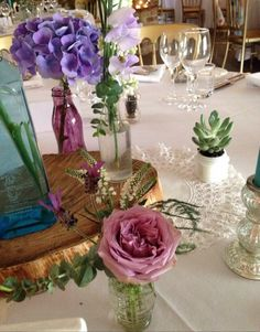 Wedding flowers and log slices by Waterbaby Flowers