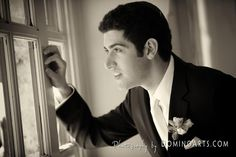 Looking out through the windows to his bride or the future? Interpretations are endless. | Wedding Portrait