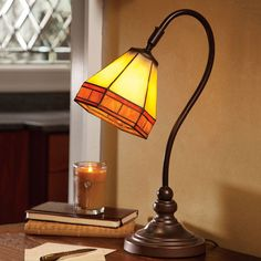 It seems like most desk lamps today are now just cold, utilitarian light sources, but this cool Tiffany-Style Stained Glass Mission Desk Lamp illuminates a desk in style.