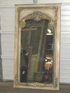 Imported New Trumeau Mirror with antique distressing and gilt molding. $1295