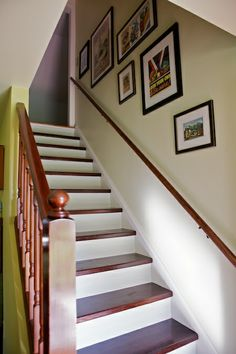 love how the stairs are painted and stained.  doesn't have to match the floor either.