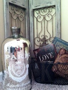 I love HOME GOODS! French glass bottle, wire farm basket filled with faux books, and old style metal shutter/ door inserts. Metal Shutters, Shutter Doors, Love Home, Still Life Photography, Glass Bottles, Home Goods, Basket, Wire, Cottage