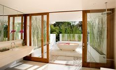 Like this bathroom indoor/outdoor - i do love white and timber look - clean.