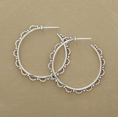 "LACY BEADED HOOP EARRINGS -- Designed exclusively for Sundance, these feminine sterling hoops are edged with lacy loops of tiny silver beads. Securing earring backs included. Imported. 1-5/8"" Dia."