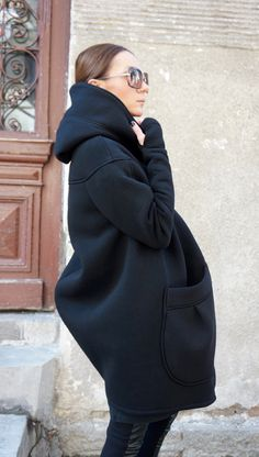 Gorgeous Hooded Black Quilted Coat / Extra Long sleeves Thumb Holes / Cotton Lined Inside  Extravagant and Unique Black Asymmetrical Coat  With Double Sided Zipper and large pocket , one inside dipper pocket ....so comfortable and always in Style!  Be Modern and Elegant and DARE to WEAR!  Different sizes available XS,S,M,L,XL,XXL,3XL, 4XL  Aakasha SIZE CHART Taking your measurements  BUST Wrap a soft tape measure around your bust. It should wrap around the fullest part of your bust....