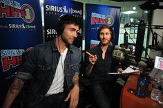 Adam Levine and Jesse Carmichael of Maroon 5 visit SIRIUS XM Studio on July 1, 2010 in New York City.