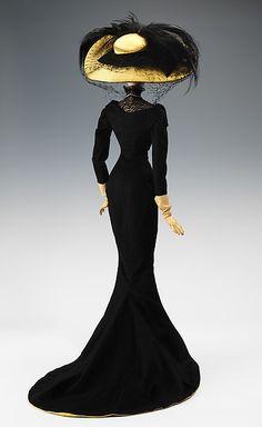 """1906 Doll"" Designer: Elsa Schiaparelli (Italian, 1890–1973) Antoine (French) André Perugia (French, 1893–1977) Date: 1949 Culture: French Medium: metal, plaster, hair, wool, silk, leather, rhinestones, imitation pearls, feather. Back"