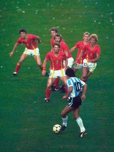 Easily one of my favourite sports images ever. Maradona vs Belgium in the World Cup in Spain '82.