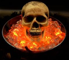 Glowing Skull Put LED submersible waterproof lights or Glow sticks in an ice bowl for this creepy Halloween decoration!