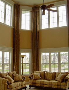 High Ceiling Curtains super high ceilings and super long drapes. not sure how thrilled i