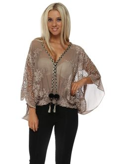 SHARE View All My Story View All Blouses & Shirts View All Tunics & Tops MY STORY Taupe Embroidered Lace Tassle Top