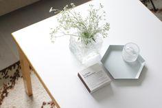 Iittala by Timo Sarpaneva (1967) vase, grey HAY hexagon tray and Merci matches from Paris on a vintage Artek coffee table.