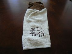 This towel is for all you cat lovers (including me) out there.  This sassy Siamese is machine embroidered on an all cotton towel.  The towel measures approximately 12 inches by 16 inches with a 4 inch
