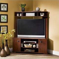 This Elegant Corner TV Unit Serves Multiple Functions. The Central Area  Accommodates TVs Up To While Adjustable Shelving Below Provides Space For  Equip