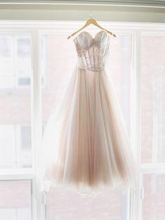 Corset bodice blush skirt wedding dress: http://www.stylemepretty.com/2015/11/27/fall-seattle-wedding-romantic-newlywed-session-at-cascade-mountains/   Photography: Christine A Clark - http://www.christineclarkphoto.com/