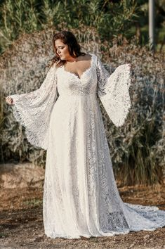 Grace by studio levana plus size all lace romantic wedding dress with bell lobg lace sleeves