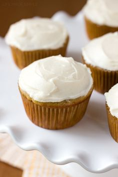 These perfectly sweet banana cupcakes are topped with a soft cinnamon cream cheese frosting. It's time to say goodbye to banana bread and hello to cupcakes!!!