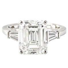 . It's a 4.48 carat Cartier platinum diamond ring. Each of the side diamonds is .54 carats. All the diamonds are color grade E, and clarity grade VS!. It comes with an official valuation report from Cartier.