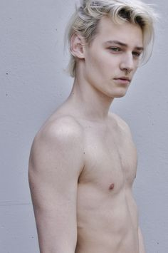 Blond twink bosses his tops