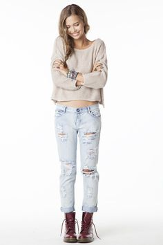 Ripped up light wash jeans, sweater, combat boots