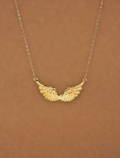 Items similar to Wing necklace - guardian angel necklace - gold wings - angel wing - kendall - a set of gold plated wings on a gold filled chain on Etsy Guardian Angel Necklace, Angel Wing Necklace, Blue Sapphire Necklace, Gold Necklace, Kendall Jenner, Cute Jewelry, Jewelry Accessories, Boutique Accessoires, Angel Aesthetic