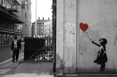 Banksy. Now the proud owner of this in wall sticker form, lovely image :)