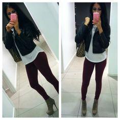 Burgundy leggings with leather jacket.