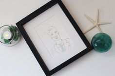 This framed mixed media art was made with genuine, surf-tumbled sea glass collected by hand along the shores of Prince Edward Island. This dapper gentleman would be the perfect gift for the handsome gentleman in your life who knows how to rock a suit. Maybe a wedding gift with a matching fancy lady ( also available in my shop)? It would be perfect in a gallery wall or a local barbershop!  It features genuine PEI sea glass in light blue, which could have originally been from an old medicine…