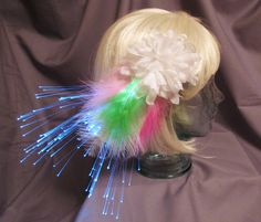 Glowing feather hair clip. A unique gift for the girl in your life that loves to dress up. This fantasy accessory is onsale! #glowing #onsale #unique #halloween #mardigras #musicfestival #funkyfashion #fantasy #accessory