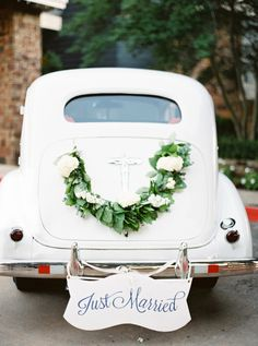 Adorable Just Married buggy: http://www.stylemepretty.com/2015/10/30/organic-greenery-texas-church-wedding/ | Photography: Stephanie Brazzle - http://stephaniebrazzle.com/