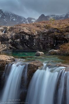 Waterfalls along the course of the Allt Coir' a' Mhadaidh river as it cascades down from the Cullin Hills, Glen Brittle, Isle of Skye, Inner Hebrides, Scotland, UK. April.